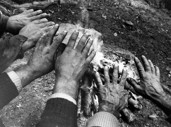 Photograph - Workers' Hands By The Fire by Emanuel Tanjala