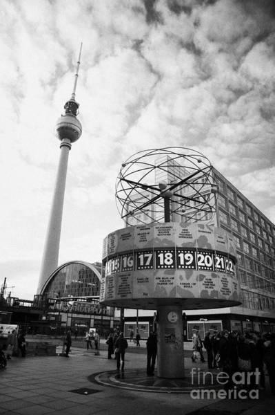 Fernsehturm Photograph - world clock Weltzeituhr at Alexanderplatz meeting place with the tv tower and Berolinahaus berlin by Joe Fox
