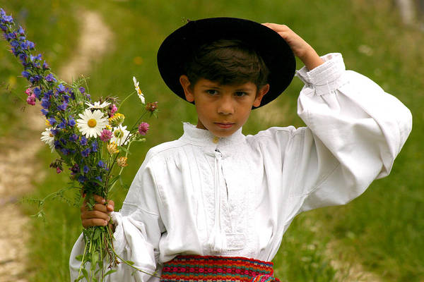 Photograph - Young Boy With Wildflowers Bouquet by Emanuel Tanjala