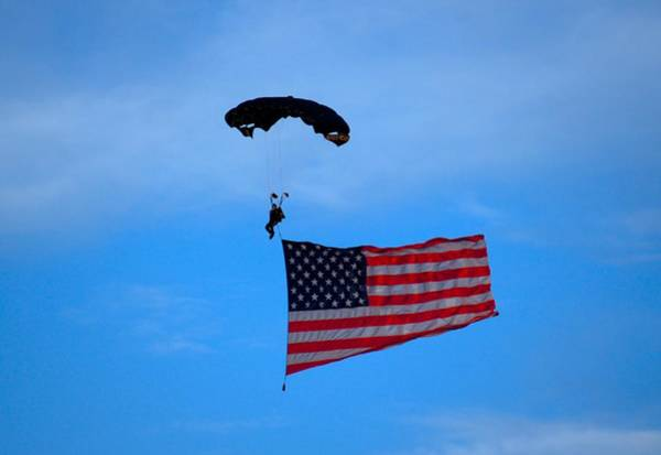 A Skydiver With An American Flag  Art Print