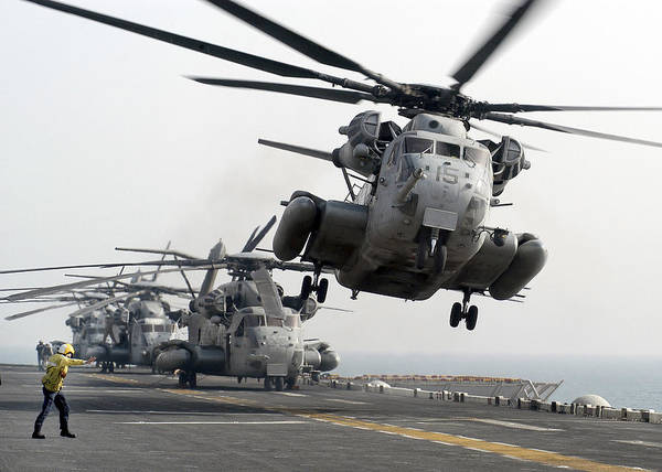 Amphibious Assault Ship Wall Art - Photograph - A Ch-53e Super Stallion Lifts by Stocktrek Images