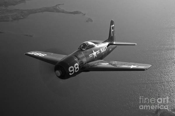 Warplane Photograph - A Grumman F8f Bearcat In Flight by Scott Germain