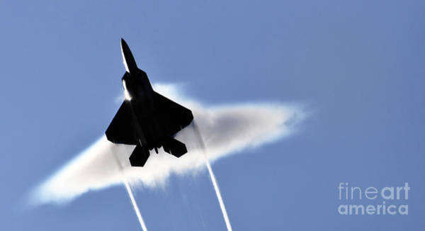 Flyby Photograph - A U.s. Air Force F-22 Raptor Aircraft by Stocktrek Images