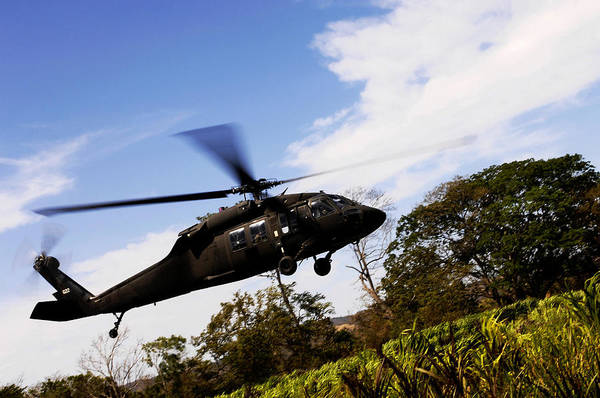 Utility Aircraft Photograph - A U.s. Army Uh-60 Black Hawk Helicopter by Stocktrek Images