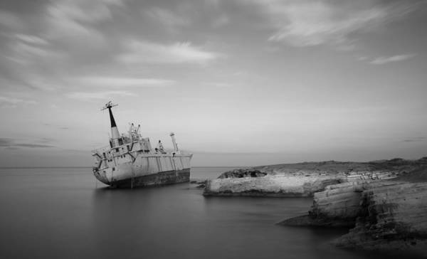 Wall Art - Photograph - Abandoned Ship On A Rocky Coast by Michalakis Ppalis