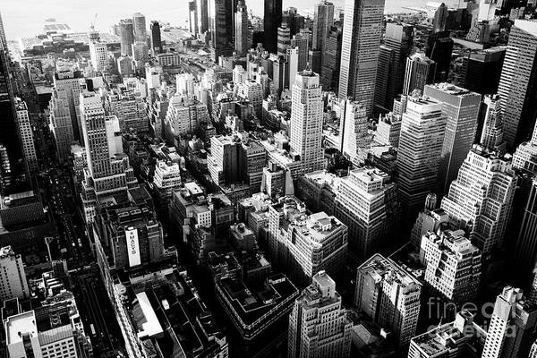 Hells Kitchen Wall Art - Photograph - aerial view over the garment and hells kitchen clinton districts of New York City USA by Joe Fox