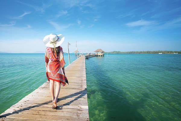 Koh Phi Phi Wall Art - Photograph - Asian Lady Walk In Wooded Bridge To Harbor In Koh Mak by Anek Suwannaphoom