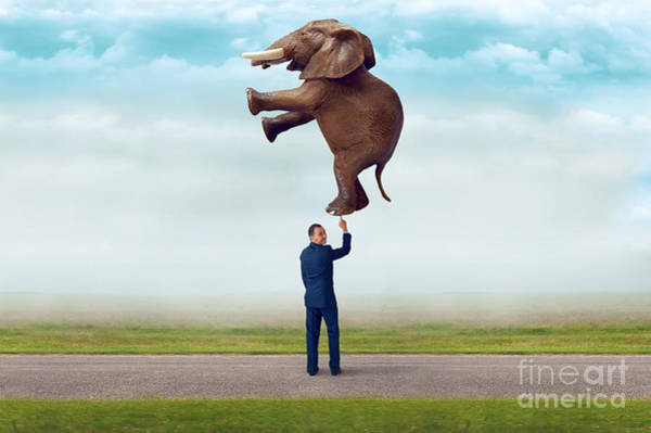 Capable Photograph - Businessman Holding An Elephant With One Finger  by Lee Avison