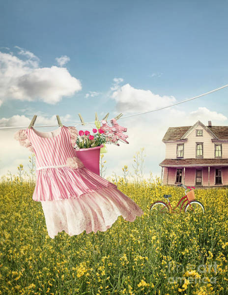 Photograph - Child's Dress And Toys Hanging On Line With Farmhouse In Backgro by Sandra Cunningham