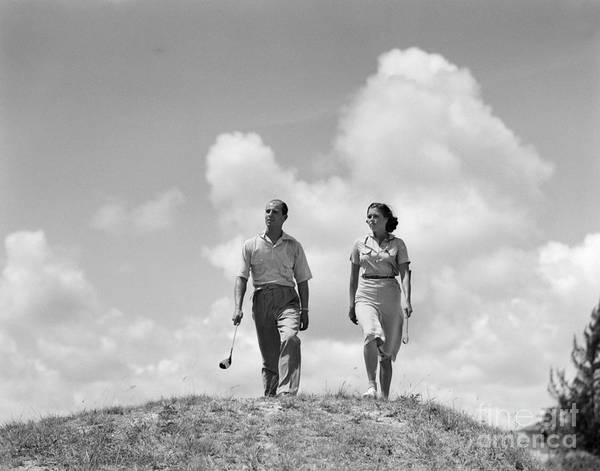 Photograph - Couple Out Golfing, C.1930s by H. Armstrong Roberts/ClassicStock