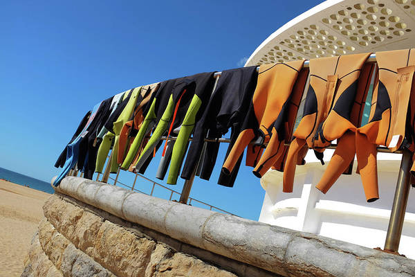 Wetsuit Wall Art - Photograph - Drying Wet Suits by Carlos Caetano