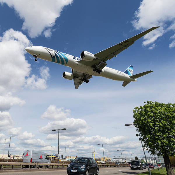 Wall Art - Photograph - Egyptair Boeing 777  Landing At Heathrow by David Pyatt