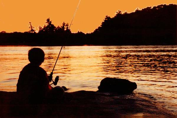 Wall Art - Photograph - Fishing From A Rock  by Lyle Crump