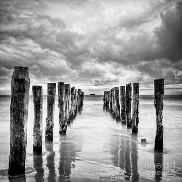 Wall Art - Photograph - Gathering Storm Clouds Over Old Jetty by Colin and Linda McKie