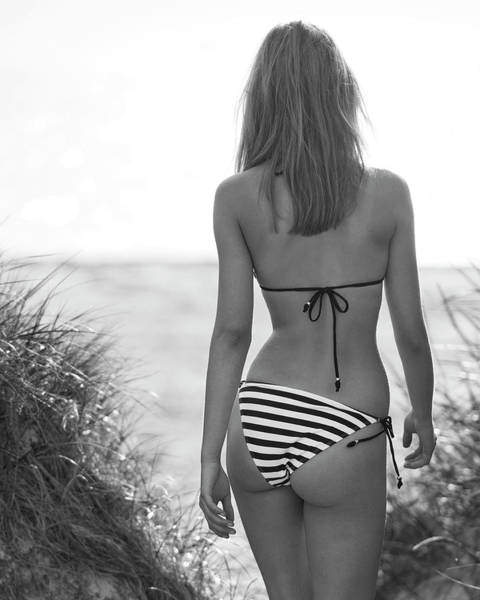 Photograph - Girl Walking Between Sand Dunes by Michael Maximillian Hermansen