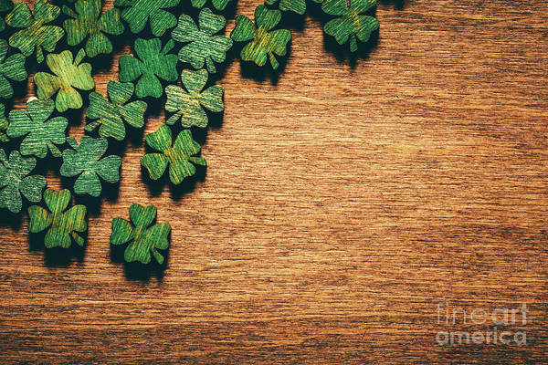Four Leaf Clover Photograph - Green Wooden Four Leaf Shamrocks On Wooden Board by Michal Bednarek