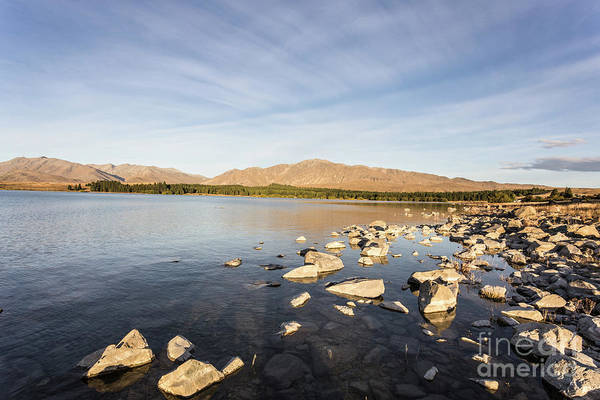 Photograph - lake Tekapo on a late summer afternoon in New Zealand  by Didier Marti