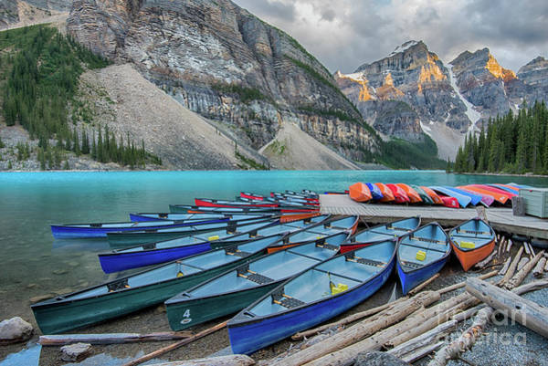 Wall Art - Photograph - Moraine Canoes Lined Up For The Night by Paul Quinn