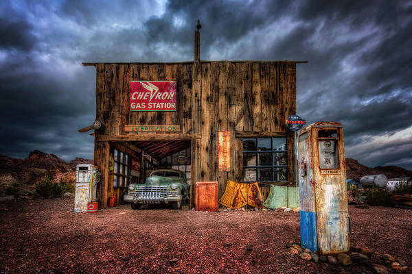 Photograph - Nelson Nevada, Weathered Garage, Car, And Gas Pump by Michael Ash