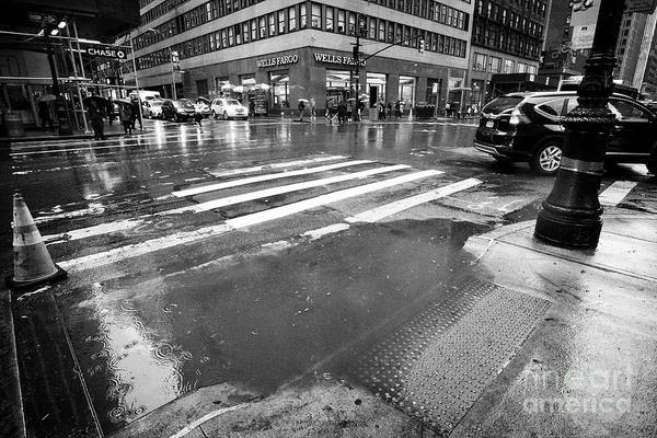 Storm Drain Photograph - rainwater starting to flood on streets New York City USA by Joe Fox