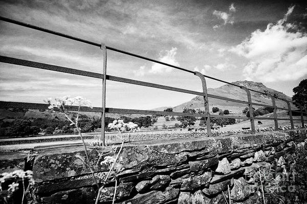 Grasmere Wall Art - Photograph - Rusty Metal Fence On Top Of Lakeland Stone Slate Dry Stone Wall With Fields And Hills Near Grasmere  by Joe Fox
