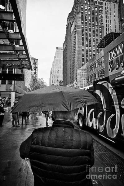 Walking In The Rain Wall Art - Photograph - senior man walking with umbrella in the rain New York City USA by Joe Fox