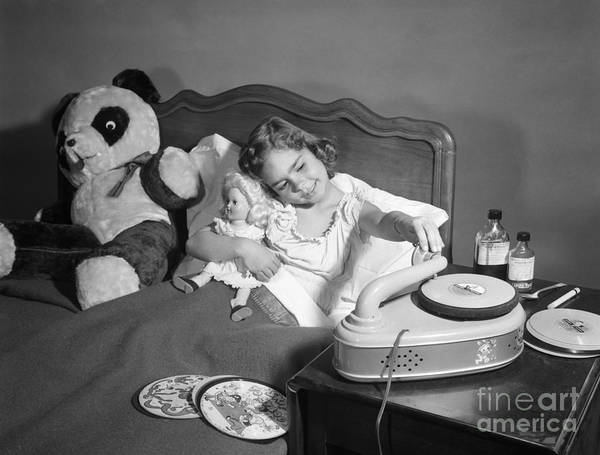 Wall Art - Photograph - Sick Girl Playing Records, C.1950s by Debrocke/ClassicStock