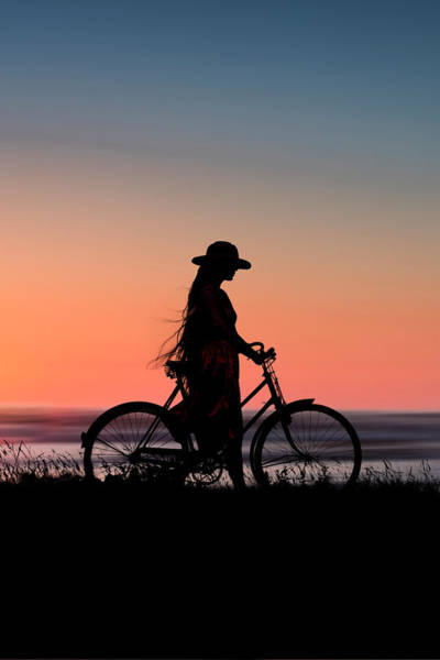 Photograph - Silhouette Of Girl And Bike At Sunset Near The Sea. by Maggie McCall