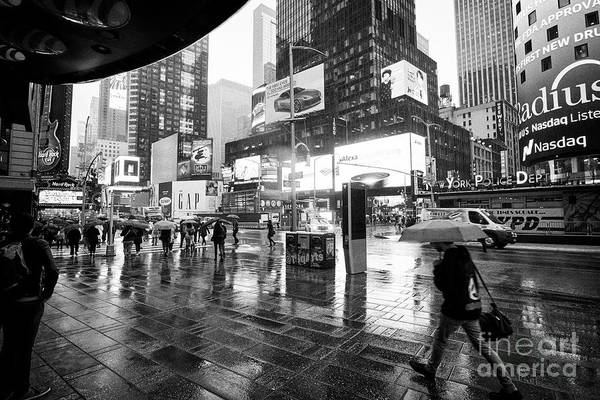Walking In The Rain Wall Art - Photograph - standing under canopy watching people walk past in the rain New York City USA by Joe Fox
