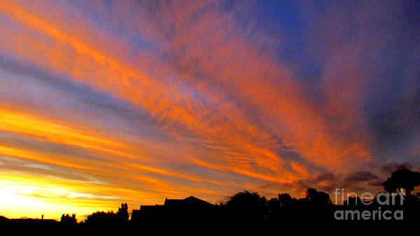 Photograph - Sunset Through The Clouds by Joyce Woodhouse