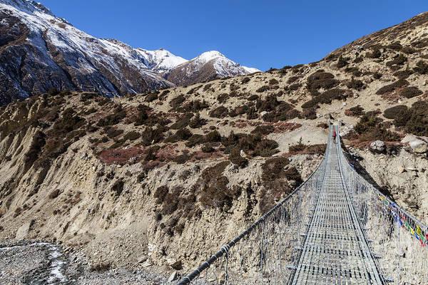 Photograph - Suspension Bridge Along The Annapurna Circuit Trek by Didier Marti
