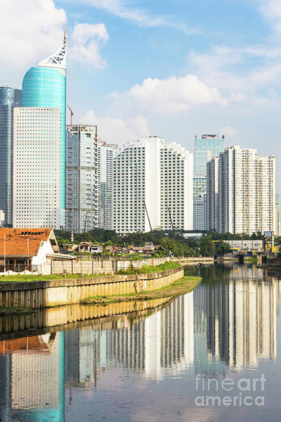 Photograph - Tall Buildings Reflection In Water In Jakarta Business District  by Didier Marti
