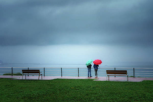 Wall Art - Photograph - Two Person With Colorful Umbrellas  by Mikel Martinez de Osaba
