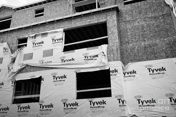 Wall Art - Photograph - tyvek homewrap on new build apartment buildings under construction Boston USA by Joe Fox