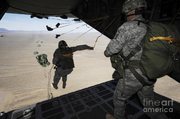 Skydiver Photograph - U.s. Airmen Jump From A C-130 Hercules by Stocktrek Images