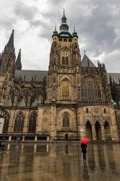 Wall Art - Photograph - Woman Walking In The Rain With A Red Umbrella At The Prague Castle by Bridget Calip
