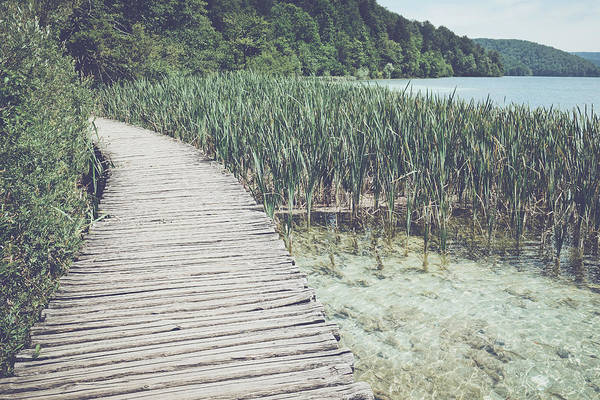 Photograph - Wooden Bridge Over A Lake In Plitvice National Park by Brandon Bourdages