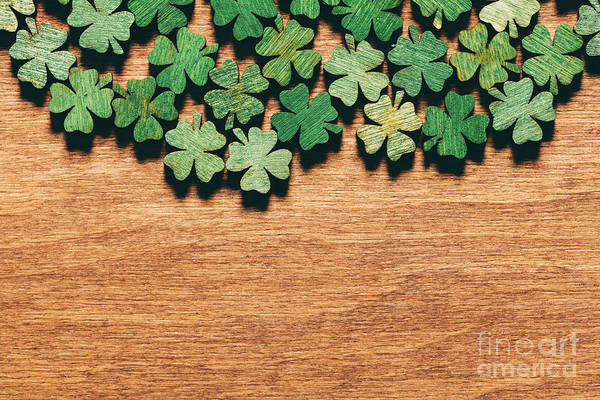 Four Leaf Clover Photograph - Wooden Green Shamrocks Laying On The Wooden Floor. by Michal Bednarek