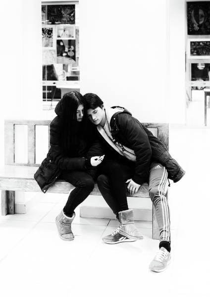 Photograph - Young Romantic Couple Sharing A Mobile Phone by John Williams