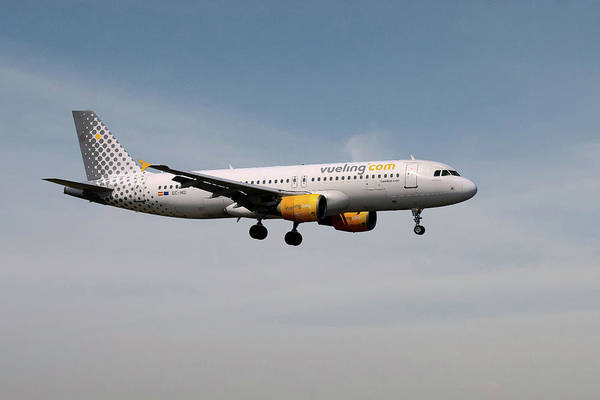 Airbus A320 Wall Art - Photograph - Vueling Airbus A320-214 by Smart Aviation