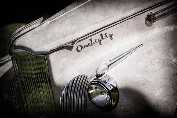 Wall Art - Photograph - 1941 Packard 1906 Darrin Convertible Victoria Grille Emblem -0393ac by Jill Reger