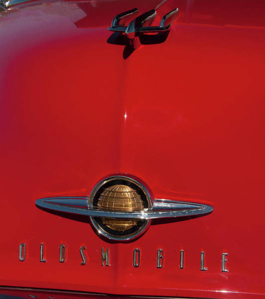 Photograph - 1950 Oldsmobile Head Badge And Hood Ornament by Chris Flees