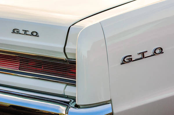 Wall Art - Photograph - 1964 Pontiac Gto Tail Light Emblems -0174c by Jill Reger