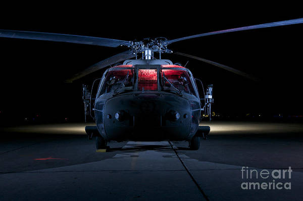 Utility Helicopter Photograph - A Uh-60 Black Hawk Helicopter Lit by Terry Moore