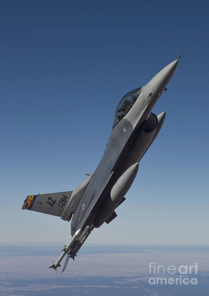 F-16 Photograph - An F-16 Fighting Falcon Maneuvers by HIGH-G Productions