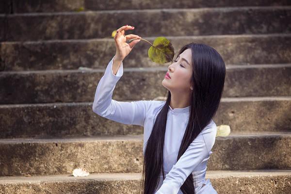 Wall Art - Photograph - beautiful Vietnamese women in traditional long dress by Huynh Thu