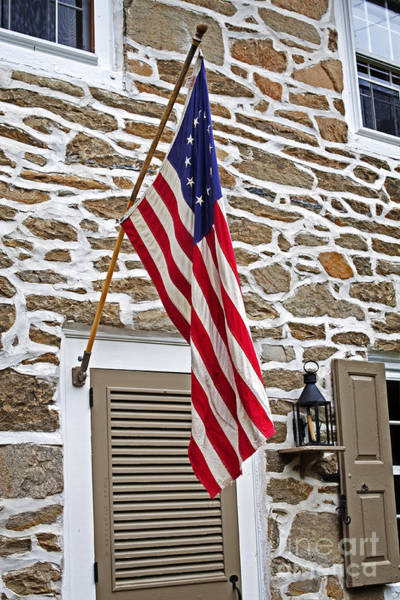 Wall Art - Photograph - Colonial Stone House With Betsy Ross Flag by John Stephens