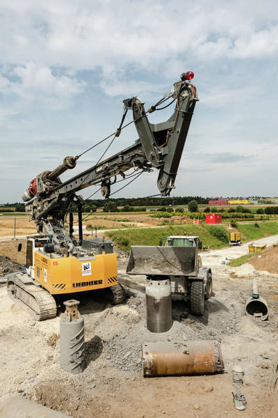 Bore Hole Wall Art - Photograph - Large Rotary Drill And Excavator On Construction Site by Frank Gaertner