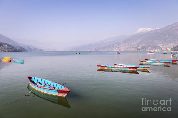 Photograph - rowbaots in Phewa lake in Pokhara in Nepal by Didier Marti
