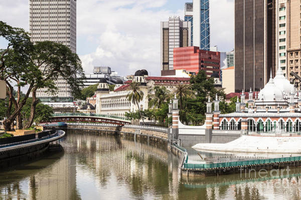 Photograph - The Office Buildings Reflects In The Water Of The Klang River In by Didier Marti